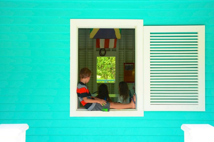 Children In House Seen Through Window