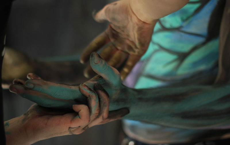 Cropped hands painting man