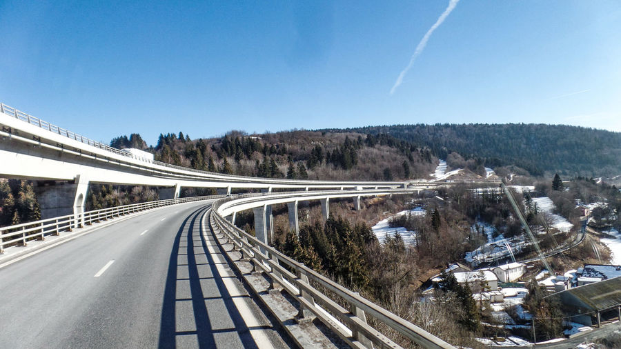Sky Transportation Road Nature Architecture Built Structure Connection Day No People Snow Winter Bridge Cold Temperature The Way Forward Bridge - Man Made Structure Clear Sky Direction Mountain City Highway Outdoors