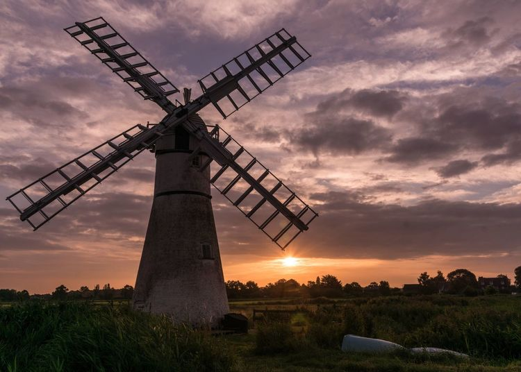 EyeEm Selects Wind Power Norfolk Norfolk Broads Field Fuel And Power Generation Sky Alternative Energy Windmill Cloud - Sky Orange Color Renewable Energy Rural Scene No People Outdoors Nature Traditional Windmill Landscape Agriculture Scenics Technology Wind Pump Wooden Structure Sunrise Thûrne