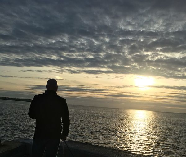 Sunset Sky Sea Cloud - Sky One Person Rear View Silhouette Men Water Horizon Over Water Beauty In Nature Nature Scenics Leisure Activity Outdoors One Man Only Day Adult People