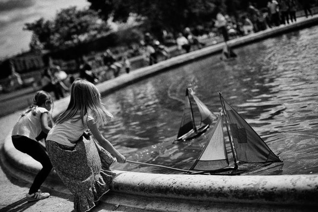 Once upon a time there were some sunny days in Paris and children could play enjoying the sun. Children Playing Games Boats Enjoying The Sun