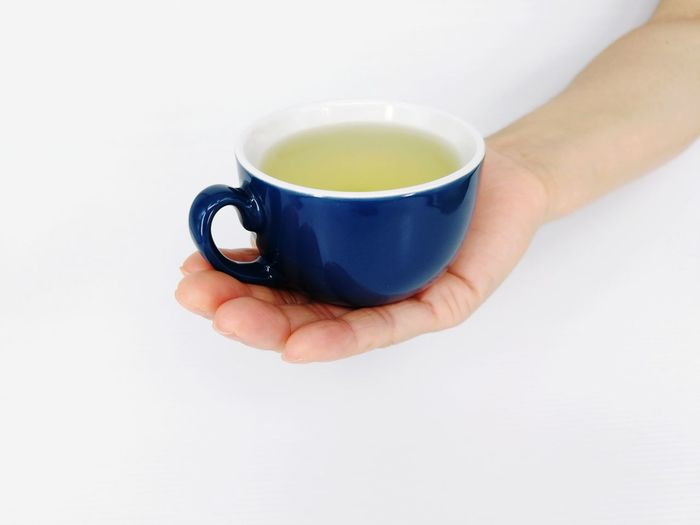 green tea EyeEm Selects Human Hand White Background Drink Tea - Hot Drink Studio Shot Teabag Holding Close-up Food And Drink Tea Cup Green Tea Herbal Tea Hot Drink Chinese Tea Japanese Tea Cup Mint Tea Black Tea Tea Matcha Tea Afternoon Tea Tea Ceremony Beverage Teapot Tea Leaves