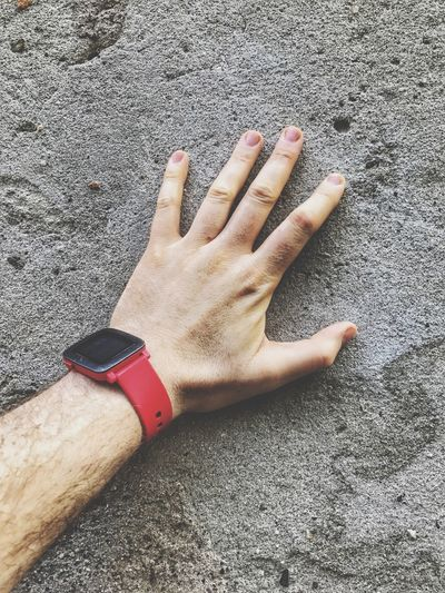 Cropped hand of man touching wall