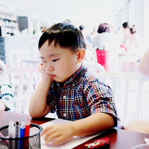 • pouting is it Friday yet ??? 😊 • The Human Condition People The EyeEm Facebook Cover Challenge Snapshots Of Life EyeEm Kids Kids Family Life Boy Attitude The Moment - 2015 EyeEm Awards
