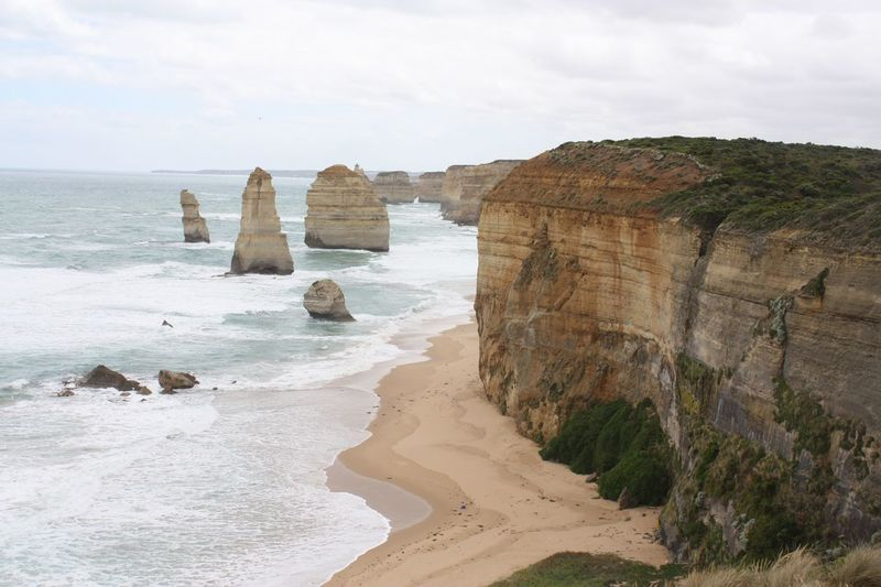 The Twelve Apostles Travel Destinations Travel Photography EyeEm Selects Sea Rock Formation Nature Scenics Rock - Object Beauty In Nature Sky Beach Horizon Over Water Sand No People Physical Geography Outdoors Cliff Day