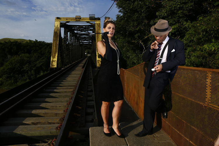 Full length of young woman on bridge against sky