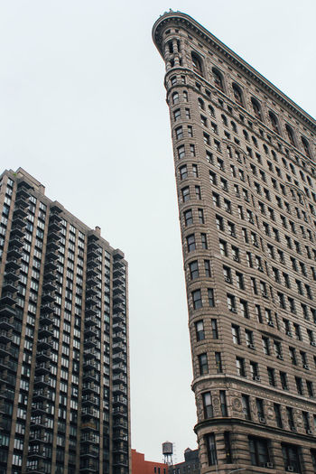 Architecture Building Exterior Built Structure City Day Flatiron Building Low Angle View New York City No People Outdoors Sky Skyscraper Tall Tower Travel Destinations