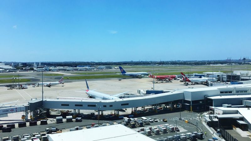 Sydney International Airport Transportation Airport Airplane High Angle View Sunlight Day Airport Runway Aerial View Passenger Boarding Bridge Outdoors Nature Architecture No People