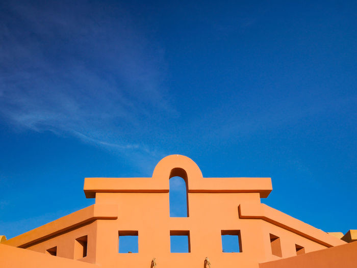 Top of orange clay building against clear blue skys Architecturelovers Arcitechturphotograph Geometric Lines Geometric Structures Clean Vibrant Color Vibrant Colors Vibrant Contrast Orange Clean Sky Egyptian Egyptian Lover Minimal Orange Wall  Autentic EyeEm Selects Blue Architecture Religion Building Exterior Travel Destinations Sunny History Built Structure Outdoors Clear Sky Day Low Angle View Multi Colored Sky No People