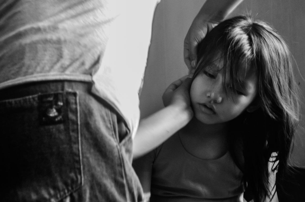 Midsection Of Father Making Daughter Hair