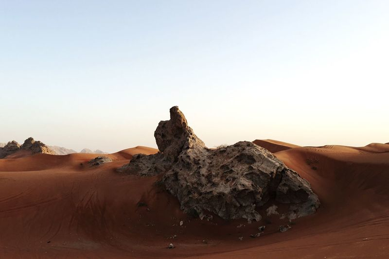 View Of Rock On Desert Against Clear Sky