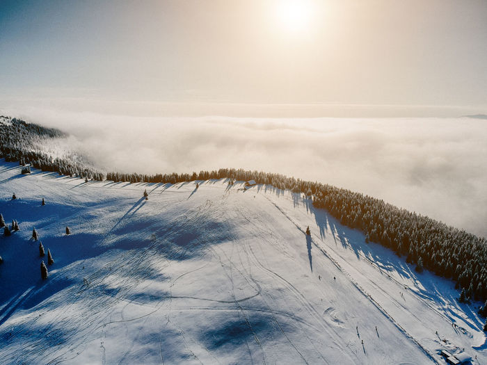 Snow Winter Cold Temperature Sky Scenics - Nature Beauty In Nature Covering Mountain Nature Sport White Color Environment Non-urban Scene Winter Sport Tranquil Scene Tranquility Landscape Land Skiing Sun Snowcapped Mountain Outdoors