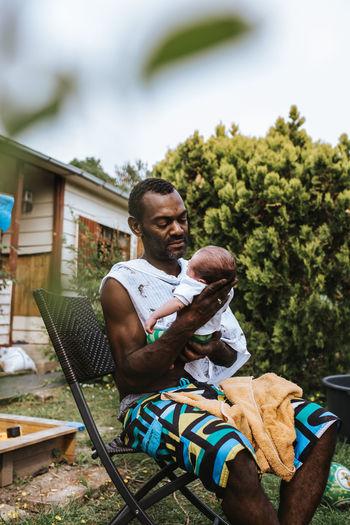 Black father holding his newborn son