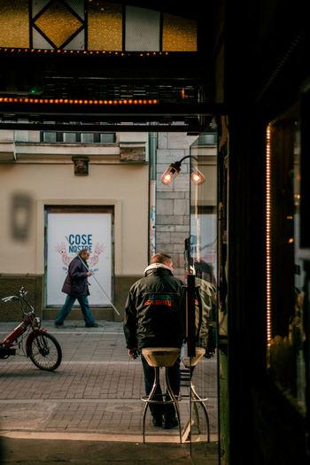 a doorway in Budapest Streetphotography Street Photography Street City Life Budapest Budapest, Hungary Streets Daily Life Portrait Street Portrait Passerby Composition Framing Framed By Doorway Door Doorway Full Length Bicycle Architecture Open Door Street Scene Entrance Front Door Ajar