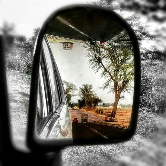 The colorful past ➖➖➖➖➖➖➖➖➖➖➖➖ Objects in the mirror are closer than they appear Past Defygravity Road Sidemirror blackandwhite pixlr colorsplash doubleexposure motog
