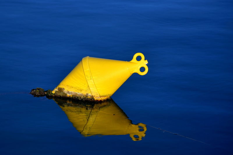 Yellow boat against blue sky