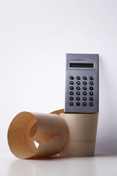 adding paper and calculator on the white background Add Budget Business Accuracy Adding Machine Bill Business Calculator Close-up Copy Space Finance Financial Item Home Finances Income Indoors  Mathematics Money No People Number Paper Purchase Receipt Studio Shot Technology White Background
