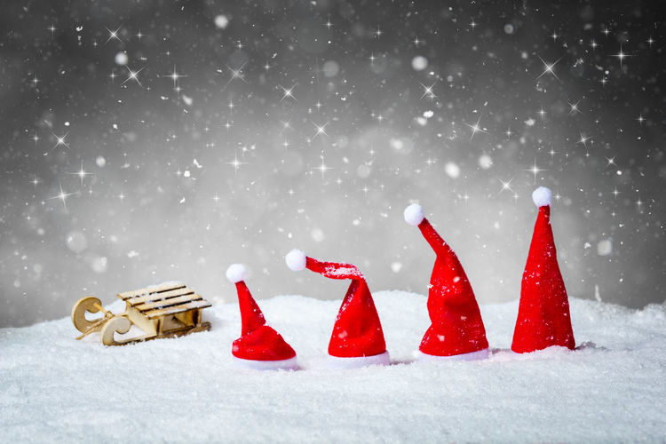 Red christmas decoration on snow