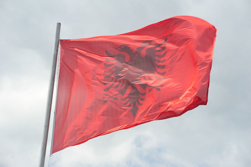 Low angle view of albania flag against sky