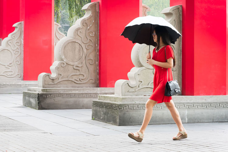 a girl in sichuan university Sichuan University Adult Architectural Column Architecture Beautiful Woman Building Exterior Built Structure Clothing Day Dress Fashion Full Length Hairstyle Hat Leisure Activity Lifestyles One Person Outdoors Protection Real People Red Security Women Young Adult