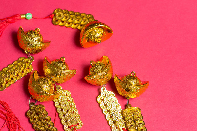 Close-Up Of Chinese New Year Decorations On Pink Background