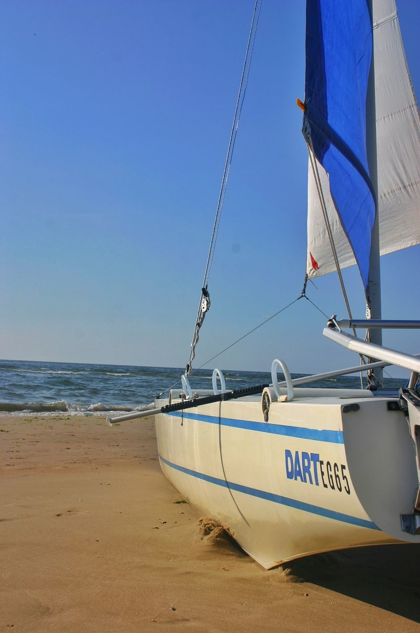 sea, sand, beach, transportation, nautical vessel, day, water, mode of transport, nature, outdoors, sky, blue, no people, horizon over water, clear sky, beauty in nature