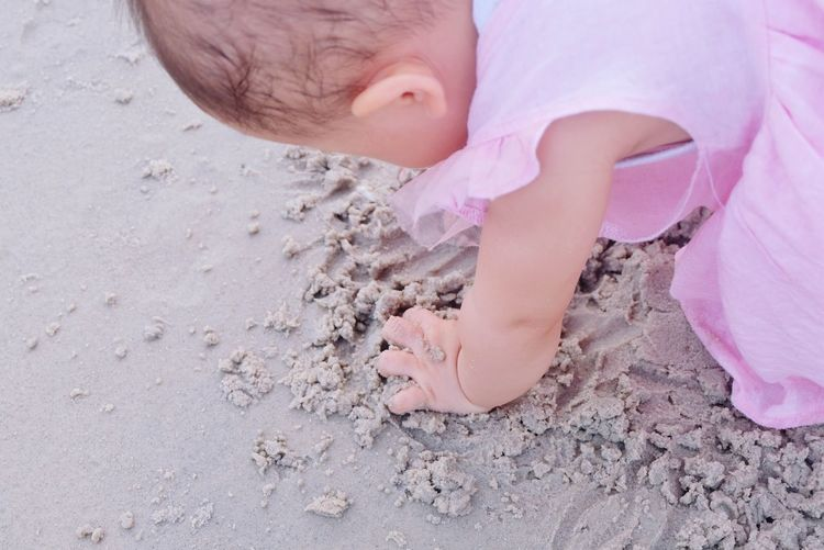 Little girl playing on sand beach Love Little Girl Playing Sandy Beach Sea Fun Kud Baby Lovely Pink Dress Child Childhood Sand Girls Pink Color Beach Close-up Finger Body Part Human Finger Hand Babyhood