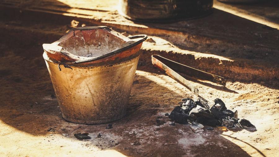 Close-up of bucket and coals