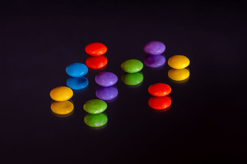 Close-up of multi colored lights against black background