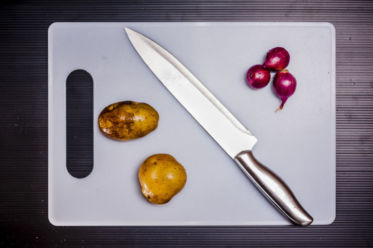 Chopping Board Commercial Cooking Cutting Boards Cuttlery Food Foodphotography Ingredients Kitchen Knife Objects Onion Potatoes Stainless Steel Knife Still Life Photography Subject Vegetable