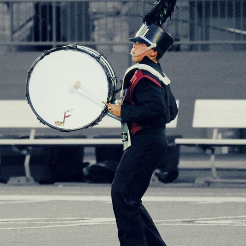 Bass drum player in marching band