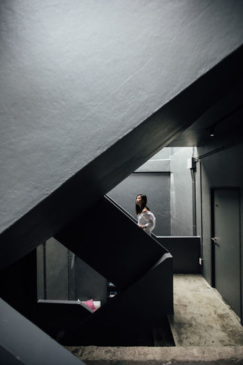 Young woman on staircase in building