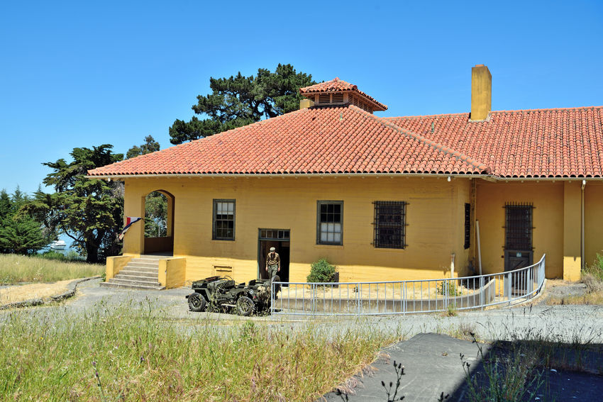 Guard House At Angel Island 1 Tiburon, Ca. Guard House Visitor's Center Military Museum Fort McDowell East Garrison Building Exterior Angel Island Houses Islands Military History Former Headquarters Officer Of The Guard Sergeant Of The Guard Open Weeknds May-Sept After Alcatraz Military Prison Closed 1920 Became Jail For Minor Offenders Jeep Military Person Spanish Tiled Roof Yacht In Bay