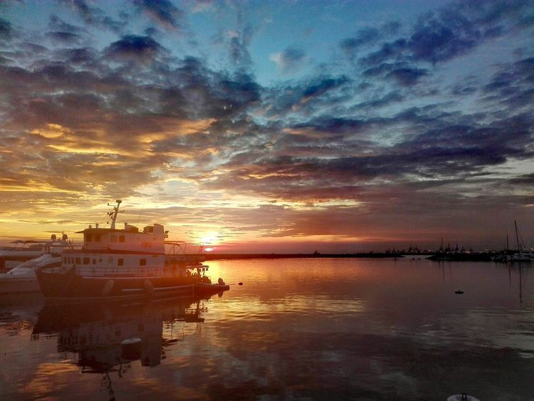Cloud - Sky Outdoors EyeemPhilippines Real People Beauty In Nature Scenics Horizon Over Water Sea Sky Water Nautical Vessel Reflection Sunset Yatch No People Multicolored Multicolored Sky