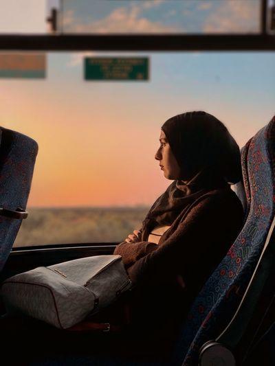 🧡 ShotOnIphone IPhoneX מייאייפון10 מייאוטובוס Real People One Person Lifestyles Sitting Leisure Activity Adult Mode Of Transportation International Women's Day 2019 My Best Photo International Women's Day 2019 The Art Of Street Photography