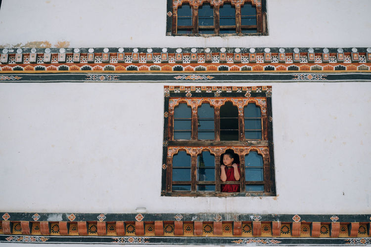 Bhutan, the world's only carbon negative country is also a traveler's paradise- from the mountains to the serene monasteries, it is culturally and naturally gifted. The Traveler - 2018 EyeEm Awards Travel Travel Photography Bhutan Color Monks Travel Destinations A New Beginning