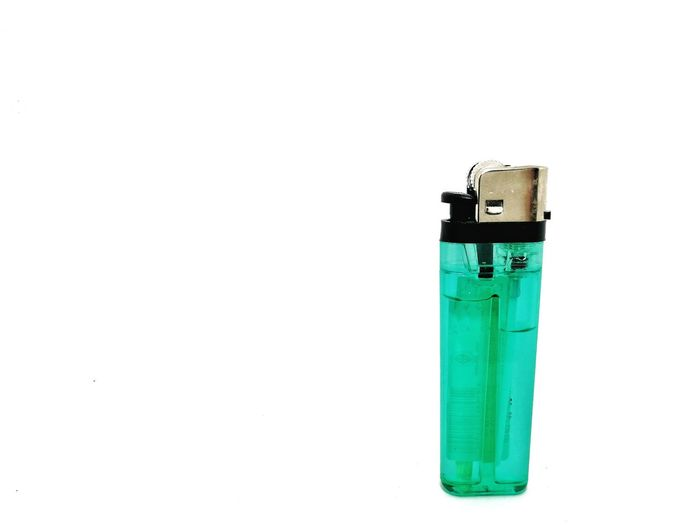 Green lighter on white background Gas Cigarette Lighter Cigartime Frame Green White Lighter Lighters Lighter Flame LighterBurn Lighter & Brighter Lighters Up Lighter Flame Lighter Fluid White Background Studio Shot Copy Space Close-up Green Color Single Object Smoking Cigarette Butt Silver
