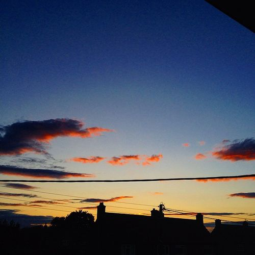 Sunset over houses House Houses Sunset Clouds Fireinthesky Phonewires RedClouds