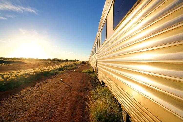 Train by field against sky