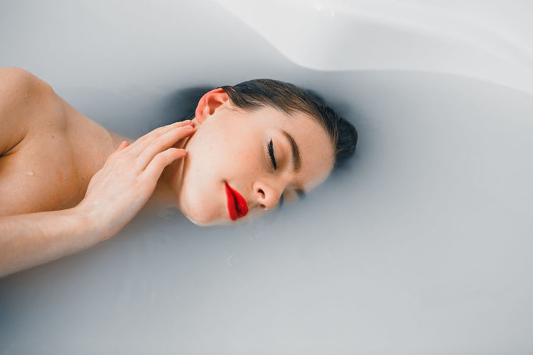 Laurélie Fashion Makeup Bathtub Beautiful Woman Beauty Domestic Bathroom Enjoyment Eyes Closed  Fashion Photography Hygiene Indoors  Leisure Activity Lifestyles Lying Down Milk One Person Pampering Red Color Red Lips Relaxation Taking A Bath Tranquility Water Wellbeing Women