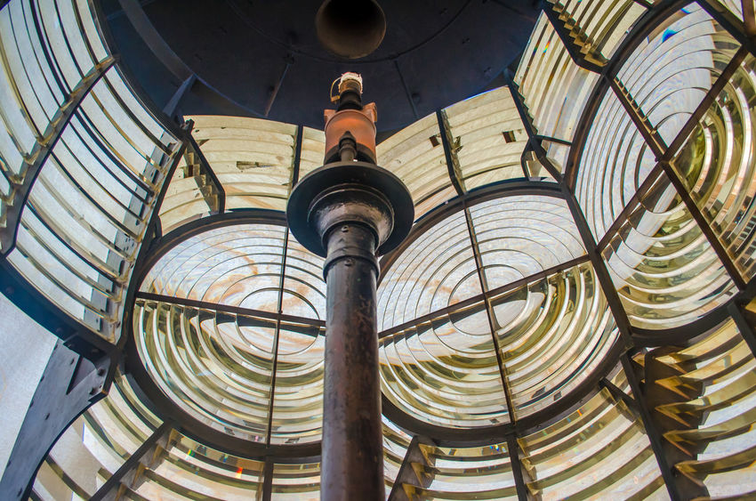 Interior of Lighthouse Fresnel lens Fresnal Light Lighthouse Travel Architecture Built Structure Day Equipment Fresnel Fresnel Lens History Indoors  Lens Low Angle View Nautical Navigation Navigator  One Person People Real People Sculpture Spiral Statue Tourism
