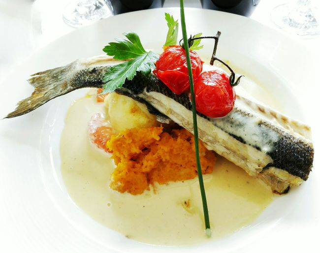 Close-Up Of Fish Served On Table