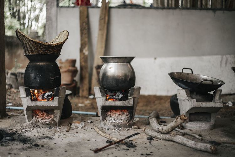 Burning Household Equipment Fire No People Container Fire - Natural Phenomenon Kitchen Utensil Heat - Temperature Stove Metal Flame Appliance Old Indoors  Day Nature Focus On Foreground Wood - Material Still Life