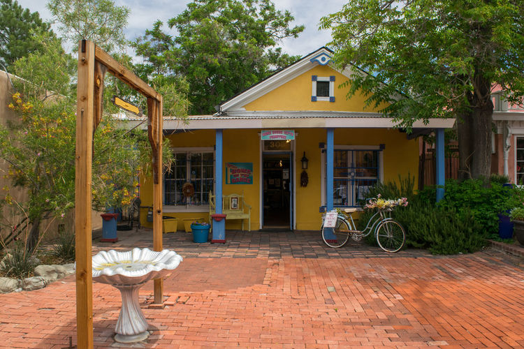 Absence Albuquerque New Mexico Architecture Bicycle Building Exterior Built Structure Chair Day Fountain No People Outdoors Seat Sky Transportation Tree Yellow House