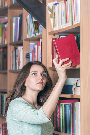 Woman holding in library