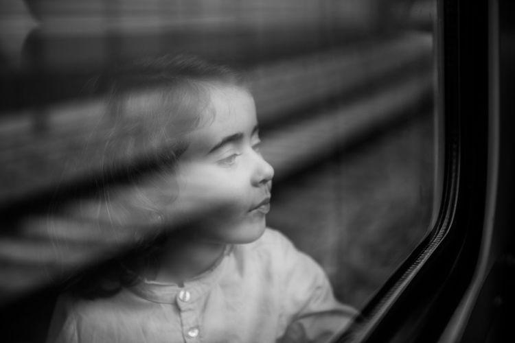 Cute Girl Looking Through Car Window
