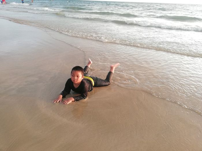 Children enjoy on summer trip 2019,หาดเจ้าหลาว Achi2019 Sea Water Beach Leisure Activity Land Real People One Person Lifestyles High Angle View Portrait Looking At Camera Enjoyment Motion Wave Men Weekend Activities Smiling Outdoors Boy