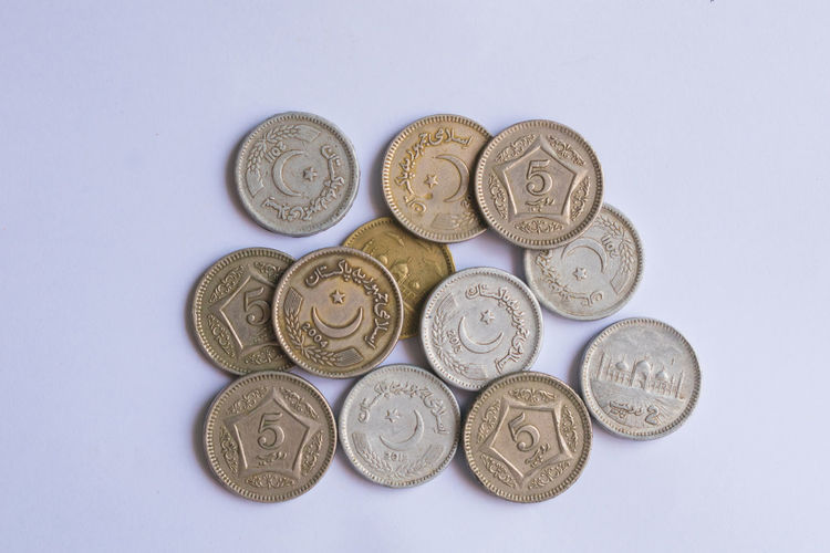 Directly above shot of coins over purple background