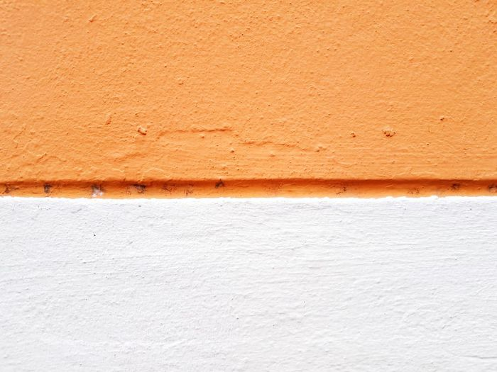 Half orange and white wall Paint Architecture Backgrounds Building Exterior Built Structure Close-up Color Concrete Copy Space Different Frame Full Frame Half Lines, Shapes And Curves Orange Color Pattern Rough Textured  Vertical Wall Wall - Building Feature White White Color